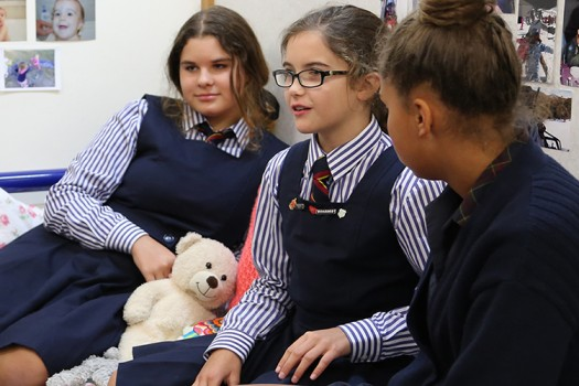 Three St Catherine's students relax in the boarding house