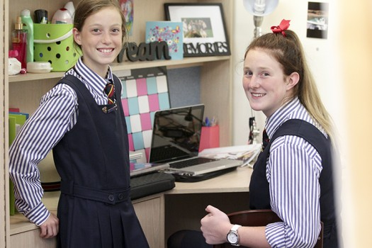 Two St Catherine's students relax in the boarding house